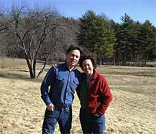 man and woman standing together in field